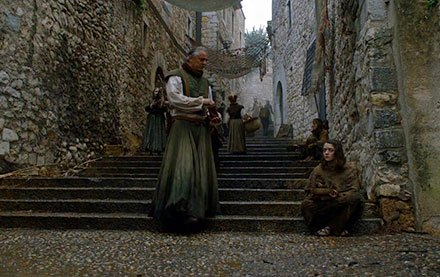 Arya Stark is blind and begging on the streets of Braavos